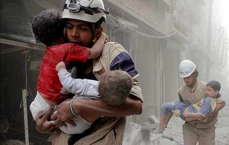 Members of the Civil Defence rescue children after what activists said was an air strike by forces loyal to Syria s President Bashar al-Assad in al-Shaar neighbourhood of Aleppo  Syria June 2  2014  REUTERS Sultan Kitaz File Photo     TPX IMAGES OF THE DAY